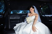 Bride in Limousine — Stock Photo