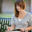 Young Student Outdoors Writing — Stock Photo