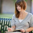 Young Student Outdoors Writing — Stock Photo #6989470