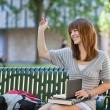 Royalty-Free Stock Photo: College girl waving hand