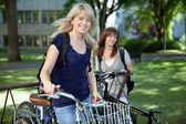 Female College Students with Bikes — Stock Photo