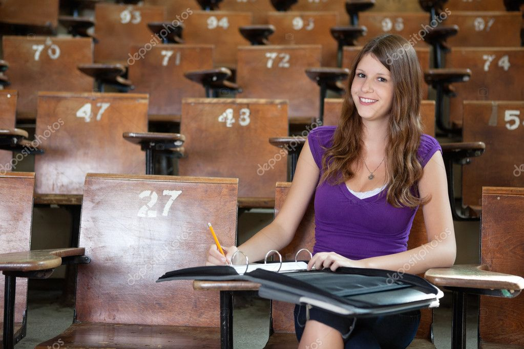 Portrait of young student completing assignment at university — Stock Photo #6989349