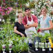 Florists with female customer — Stock Photo