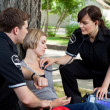 Stock Photo: Emergency Medical Professionals Measuring Vitals