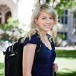 Sweet smiling college girl - Stock Photo