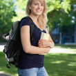 College student with book and bag — Stock Photo