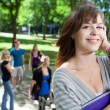 Young college girl smiling — Stock Photo