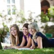Girls using laptop — Stock Photo