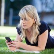 Stock Photo: Young girl using cell phone