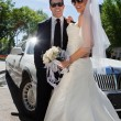 Newly wed couple in sunglasses - Stock Photo