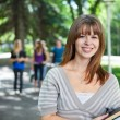 Portrait of smiling young college girl — Stock Photo #6997035