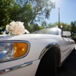 Wedding bouquet on the car - Stock Photo