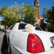 Stock Photo: Wedding Limo and Church