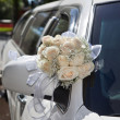 Wedding Bouquet on Limo — Stock Photo
