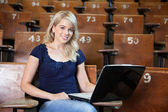 College girl using laptop — Stock Photo