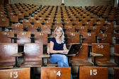 Woman Student in Empty Lecture Hall — Stock Photo