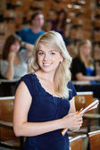College Girl Standing in Lecture Hall — Stock Photo