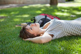 Girl lying down at college campus — Stock Photo