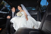 Bride and Groom in Limo — Stock Photo