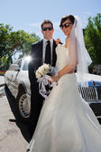 Newly wed couple in sunglasses — Stock Photo
