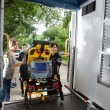 Loading Patient in Ambulance - Stock Photo