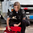 Stock Photo: EMS Professional with Portable Oxygen Unit