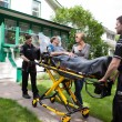 Foto Stock: Senior Woman on Ambulance Stretcher