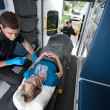 Senior Woman Receiving Emergency Medical Care - Stock Photo