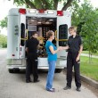 Elderly Woman with Ambulance Staff — Stockfoto #7089238