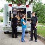 Elderly Woman with Ambulance Staff — Stock Photo