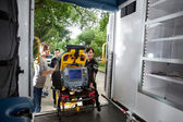 Loading Patient in Ambulance — Stock Photo