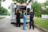 Elderly Woman with Ambulance Staff — Stock fotografie