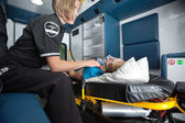Ambulance Interior with Senior Woman — Stock Photo