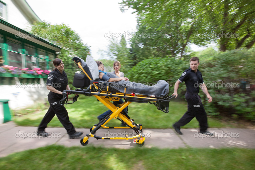 Senior woman being rush to hospital by ambulance staff — Stock Photo #7088393