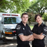 Paramedic Portrait with Ambulance — Stock Photo