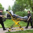 Senior on Ambulance Stretcher — Stock Photo
