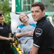 Ambulance Worker with Patient — Stock Photo #7094262