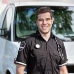 Paramedic Man Standing near Ambulance — Stock Photo #7094388