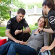 EMT Professionals with Patient - Stock Photo