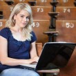 Woman with Laptop in Lecture Hall — Stock Photo