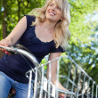 Attractive Female Student Riding Bike — Stock Photo