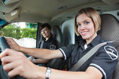 Happy Female Paramedic in Ambulance — Stock Photo