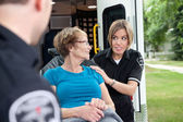 Ambulance Worker with Patient — Стоковое фото