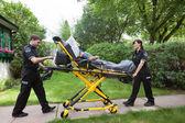 Senior on Ambulance Stretcher — Stock Photo