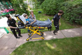 Senior Woman with Emergency Medical Help — Stock Photo