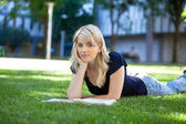 Relaxed female student with book — Foto de Stock
