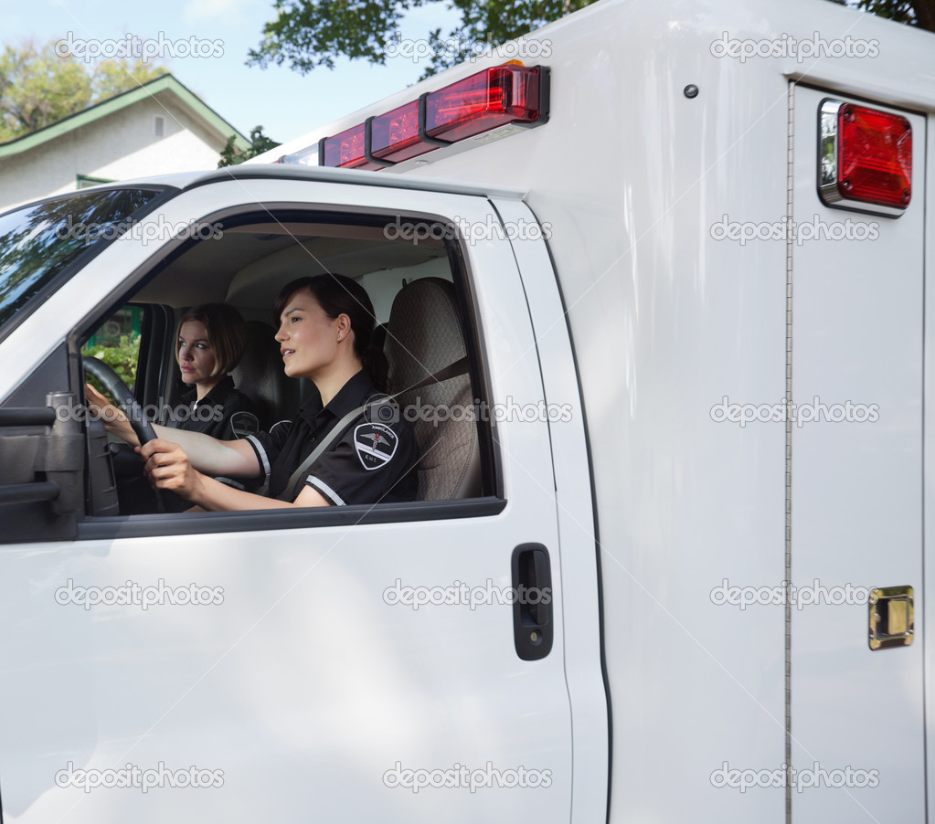 Two female ambulance professionals in a vehcile — Stock Photo #7093614