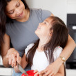 Mother and Daughter Cutting Vegetables - Stockfoto