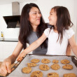 Mother and Daughter Baking Cookies — Stock Photo #7285203