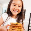 Happy Cute Girl Holding Cookies — Stock Photo